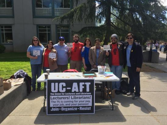 UC AFT Local 2023 and UAW 2865 tabling on opening day of librarian contract bargaining on April 17.